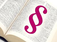 Aufgeschlagenes Buch mit großem Paragrafen-Zeichen